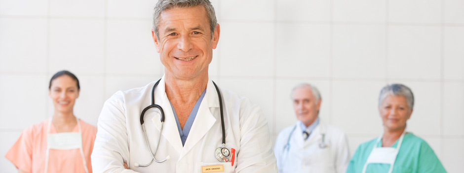 Physician smiling after getting coverage from Gulf Atlantic Medical Malpractice Insurance Company.